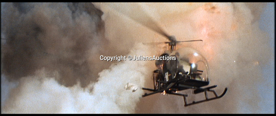 BNPS.co.uk (01202 558833)<br /> Pic: JuliensAuctions/BNPS<br /> <br /> ***Please Use Full Byline***<br /> <br /> The helicopter prop that was blown up in the James Bond film, You Only Live Twice. <br /> <br /> The iconic micro-jet flown by Roger Moore in Octopussy and the swivel chair used by super-villain Blofeld are among a host of props from James Bond movies coming up for sale.<br /> <br /> The 12ft long BD-5J red, white and blue aircraft, that is the world's lightest jet, was piloted by 007 in the opening scenes of Octopussy, outwitting his Cuban captors.<br /> <br /> The aircraft was actually built seven years before the film as part of an air display team and was hired for the 1983 Bond flick.
