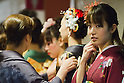 February 18, 2012, Tokyo, Japan - Contestants dressed in kimonos prepare themselves prior to getting on stage during the 2012 Kimono Queen Contest. Approximately 500 women dressed in beautifully designed kimonos participate in this annual event for a chance to win special prizes and given the opportunity to be recognized as a kimono model in various media outlets. (Photo by Christopher Jue/AFLO)