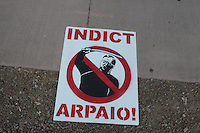 Phoenix, Arizona. June 25, 2012 - Signs like this opposing Maricopa County Sheriff  Arpaio were used during a demonstration to oppose the U.S. Supreme Court ruling on a SB 1070's provision that advocacy groups say will promote racial profiling. The Justice Department has sued Arpaio. Immigrant rights groups protested the United States Supreme Court ruling on Arizona law for upholding SB 1070's provision that will allow police to demand papers if there's reasonable suspicion that a person may be illegally in the country. Photo by Eduardo Barraza © 2012