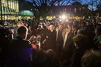 FROM LEFT IN SPOTLIGHT: Parents and siblings of Deah Barakat, including his sister Suzanne Barakat, father Namee Barakat, mother Layla Barakat, and Suzanne's husband Zubair Jandali talk to reporters as thousands gathered for a vigil and memorial for shooting victims at The Pit at The University of North Carolina at Chapel Hill in Chapel Hill, North Carolina on Wednesday, February 11, 2015. Craig Hicks, 46, of Chapel Hill has been charged with three counts of first-degree murder in the killings of Deah Barakat, 23, a UNC student; his wife, Yusor Abu-Salha, 21; and her sister, Razan Abu-Salha, 19. (Justin Cook)