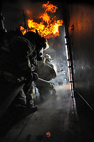 Ian Stewart/Yukon News<br /> Fire Marshal Dennis Berry, centre, and training officer Donovan Misener use the Mobile Fire Training Unit. The Fire Marshal's Office and the Whitehorse Fire Department are looking for new volunteer firefighters.