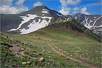 Near the town of Winter Park, an old dirt road heads up into the mountains. Several miles up, a trail leads off towards the higher  Front Range peaks - one of which is James Peak. By Colorado standards, James Peak isn't that imposing, standing only 13,300 feet. However, it does make for a nice walk up and provides a great view of Winter Park and the Fraser valley.<br />