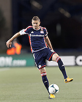 New England Revolution defender Chris Tierney (8) traps the ball.In a Major League Soccer (MLS) match, the New England Revolution (blue/red) defeated Philadelphia Union (blue/white), 2-0, at Gillette Stadium on April 27, 2013.