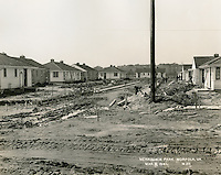 1941  March  06..Merrimack Landing   ..Merrimack Park.Defense Housing Project VA-6-1.Looking West along roadway between D-1-17 &  D-1-20.#20...NEG#.3508..