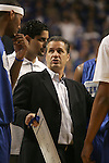 UK head coach John Calipari talks to forward DeMarcus Cousins during a time out in the first half of the Blue and White scrimmage at Rupp Arena Wednesday night..Photo by Zach Brake | Staff