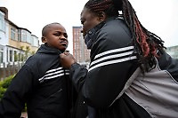 """48 year old Augustine from DR Congo walks the streets of North London with her son Jeneil . She worked as a nurse in a hospital in DR Congo but fled after she was arrested for her involvement in an opposition political party. she has her six year old son Jeneil with her and both are destitute, sleeping in churches, on friends' floors and sometimes outside. Her son has a school place but because she is always sleeping in different places and has no money for bus fares it is sometimes hard to make sure he attends. """"My son and I only eat once a day. My church gives me two to five GBP a week and I use that money to buy fruit for my son."""" Augustine is one of an estimated 300,000 rejected asylum seekers living in the UK."""