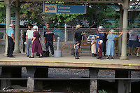 amish family awaits amtrak railroad