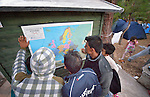 Refugees and migrants study a map in the city park on the Greek island of Chios. The park is full of tents sheltering refugees who crossed the Aegean Sea in small boats from Turkey. They were registered and provided with food and shelter in a reception center built with support from International Orthodox Christian Charities, a member of the ACT Alliance. Many of them then move to the city park where they await a ferry to take them to Athens and then on toward western Europe. Hundreds of thousands of refugees and migrants have passed through Greece in 2015.
