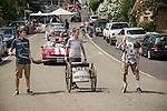 "Three kids following the horse with shovels ""Moke Hill Sanitation Dept."" Downtown main street during the Independence Day celebration Main Street, Mokelumne Hill, California"