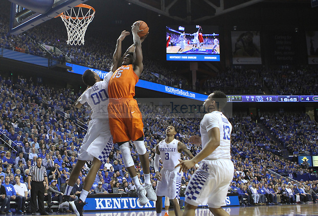 Florida center John Eqbunu (15) gets blocked by UK forward Marcus Lee (00) during the UK Men's Basketball vs. Florida Gators game at Rupp Arena. Saturday, February 6, 2016 in Lexington, Ky. UK defeated Florida 80 - 61