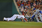 20 September 2012: Washington Nationals shortstop Ian Desmond dives safely back to first as Los Angeles Dodgers first baseman Adrian Gonzalez prepares to catch the pickoff attempt during a game at Nationals Park in Washington, DC. The Nationals defeated the Dodgers 4-1, clinching a playoff birth: the first time for a Washington franchise since 1933. Mandatory Credit: Ed Wolfstein Photo