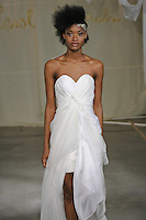 Model walks runway in a Juniper wedding dress by Carol Hannah Whitfield, for the Carol Hannah Spring Summer 2012 Bridal collection runway show.