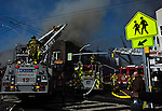 New Jersey, United States. 10th March 2013 -- New Jersey Firefighters battle a six-alarm fire at a New Jersey industrial building that has extended to some adjoining buildings at the town of Harrison. Photo by Eduardo Munoz Alvarez / VIEWpress.