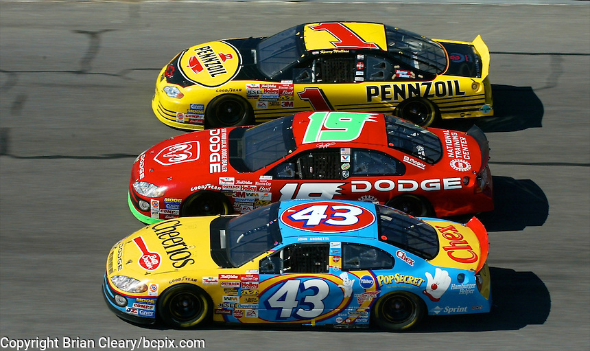 John Andretti (43), Jeremy Mayfield (19) and Kenny Wallace (1) race 3-wide during the Daytona 500, Daytona International Speedway, Daytona Beach, FL, February 17, 2002.  (Photo by Brian Cleary/www.bcpix.com)
