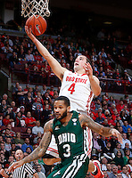 Ohio State Buckeyes guard Aaron Craft (4) makes a layup while defended by Ohio Bobcats guard Javarez Willis (3) during Tuesday's NCAA Division I basketball game at Value City Arena in Columbus on November 12, 2013. (Barbara J. Perenic/The Columbus Dispatch)