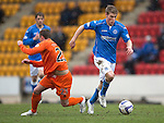 St Johnstone v Kilmarnock.....28.02.15<br /> David Wotherspoon goes by Chris Chantler<br /> Picture by Graeme Hart.<br /> Copyright Perthshire Picture Agency<br /> Tel: 01738 623350  Mobile: 07990 594431