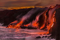 Lava streams enter the ocean near Kalapana on the Big Island of Hawai'i.