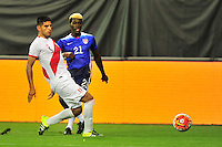 Gyasi Zarde of US tries to center the ball agains a defenders . USA defeated Peru 2-1 during a Friendly Match at the RFK Stadium in Washington, D.C. on Friday, September 4, 2015.  Alan P. Santos/DC Sports Box