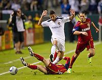 CARSON, CA - November 6, 2011: LA Galaxy midfielder Juninho (19) and Real Salt Lake forward Fabian Espindola (7) during the match between LA Galaxy and Real Salt Lake at the Home Depot Center in Carson, California. Final score LA Galaxy 3, Real Salt Lake 1.