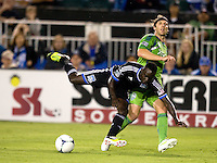 Simon Dawkins of Earthquakes tries to tackle the ball during the game against Seattle at Buck Shaw Stadium in Santa Clara, California on August 11th, 2012.   Earthquakes defeated Sounders, 2-1.