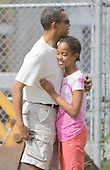 Kailua, HI - December 30, 2008 -- United States President-Elect Barack Obama embraces his oldest daughter Malia before entering the Honolulu Zoo on Tuesday,  December 30, 2008 in Honolulu, Hawaii.  Obama and his family arrived in his native Hawaii December 20 with his family for the Christmas holiday..Credit: Kent Nishimura - Pool via CNP