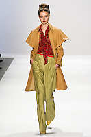 AJ Strutman walks the runway in a Luca Luca Fall 2011 outfit, designed by Raul Melgoza, during Mercedez-Benz Fashion Week, February 10, 2011