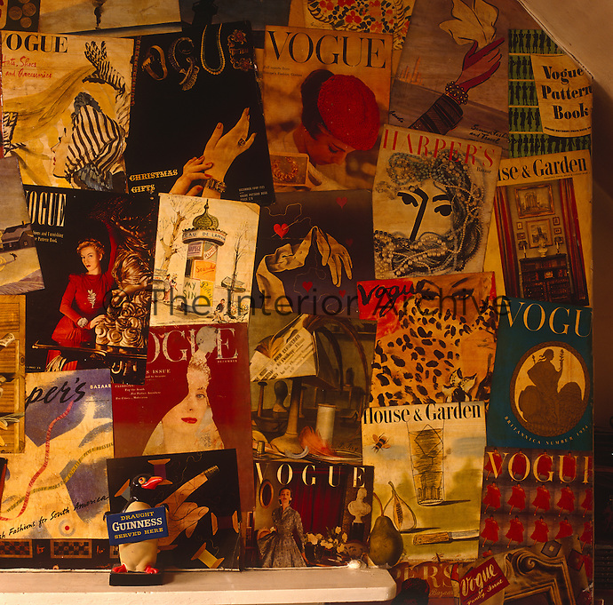 A varnished montage of original vintage magazine covers from the 1930s and 1950s has been pasted around the chimney breast of an attic room
