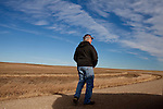 Kendrick Brinson.LUCEO..Larry Berg, 64, stands in a field outside of Williston, North Dakota in January 2012. Larry bought the land he farms in 1988 and leases 40 acres to oil companies. Williston is currently experiencing an influx of people relocating there for the town's third oil boom...Model Released: yes.Assigning Editor: Michael Wichita.