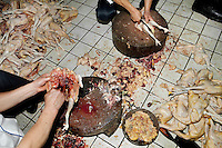 Chickens being prepared in the kitchens of The West Lake Restaurant. Able to seat up to 5,000 people at one sitting, The West Lake Restaurant is the biggest Chinese restaurant in the world. Each week its diners, who staff are taught are 'the bringers of good fortune', devour 700 chickens, 200 snakes, 1,200 kgs of pork and 1,000 kgs of chillis. Its 300 chefs cook in five kitchens and its staff total more than 1,000.It is fully booked most nights.