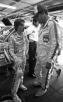 Mark Martin, left, and Buddy Baker talk in the garage area before the Firecracker 400 Daytona International Speedway Daytona Beach FL July 1982.(Photo by Brian Cleary/www.bcpix.com)