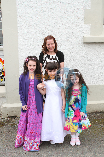 Emer Bellew with her mother Sylvia and her cousins Ciara and Alana at Phillipstown Communion in St.Kevins Church...(Photo Jenny Matthews/www.newsfile.ie)