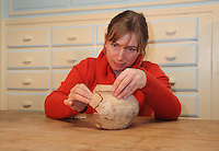 Karine Marquet, head of the department of Administration and Study of Archaeological Artefacts, restoring a terracotta pot in the Laboratoire d'Archeologie, Chateau-Thierry, Picardy, France. Picture by Manuel Cohen
