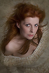 red haired woman looking at camera