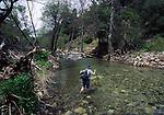 Woman hiking across Tassajara Creek