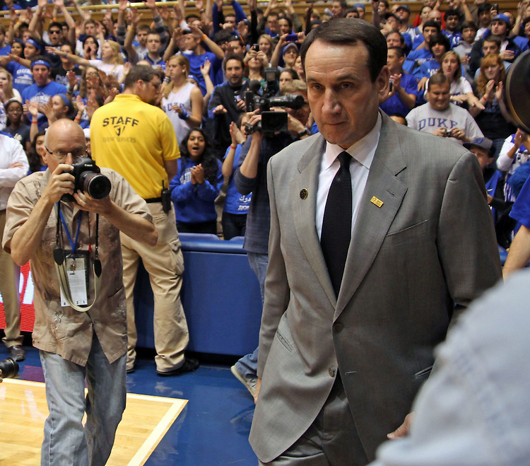 Head Coach Mike Krzyzewski enters the court before the start of the game. Duke beat Presbyterian 96-55 on Saturday, November 12, 2011 at Cameron Indoor Stadium in Durham, NC. It was win number 902 for Duke head coach Mike Krzyzewski, tying him with Bob Knight for the NCAA DivisionI all-time win record. Photo by Al Drago.