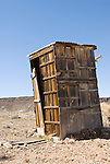Wooden leaning outhouse in the town of Goldfield, Nev.