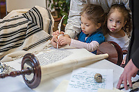 Members and friends of the Chabad of Harlem finish the final letters of their Sefer Torah in Harlem in New York on Sunday, October 27, 2013. The ten year old synagogue commissioned the hand-written parchment scroll (which contains 304,805 Hebrew letters) two years ago. Harlem was once home to over 200 synagogues before the Great Depression and current census records have shown that the caucasian population now outnumbers african-americans.  (© Richard B. Levine)