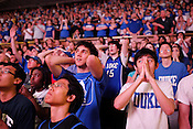Duke students Michael Whited, left, and Stephen Han witness the final seconds of the NCAA championship game against the Bultler Bulldogs inside Cameron Indoor Stadium. The Blue Devils eeked out a win 61-59 in a breathtaking finish to an unexpected championship season, the fourth for the university.