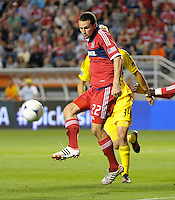 Chicago defender Austin Berry (22) plays the ball in front of Columbus' Aaron Schoenfeld (34).  The Chicago Fire defeated the Columbus Crew 2-1 at Toyota Park in Bridgeview, IL on June 23, 2012.