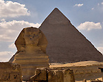 Giza, Cairo, Egypt -- The Great Sphinx, part of the funerary temple of Khafre (Kephren), sits in front of the processional causeway that leads to Khafre's pyramid, in the background. © Rick Collier / RickCollier.com.