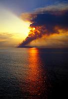 Sugarcane fire in Maalaea with sunset and Mt. Haleakala