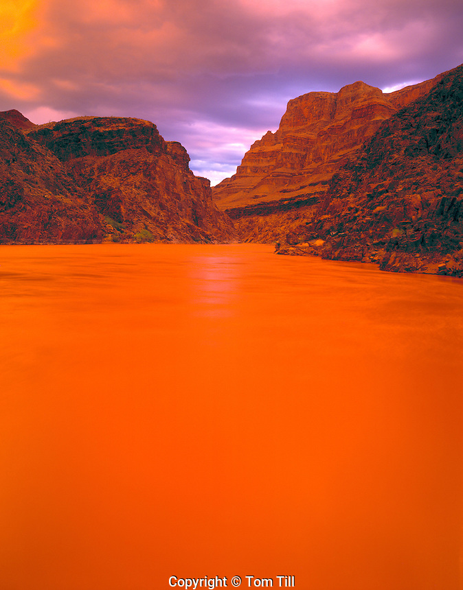 Stormlight & River Running Red, Grand Canyon National Park, Arizona    Near River Mile 219   Orange color from stromlight and  red silt in river