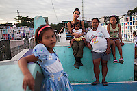 (L-R) Christine Joy, 9, UK celebrity Myleene Klass holding Carla Mae, 2, Rose Marie Ferrer, 33, and Charlene, 11, pose for a group portrait in an inhabited cemetery where they live in Paranaque City, Metro Manila, The Philippines on 18 January 2013. Myleene Klass had come to visit Rose who owns a shop in the cemetery where she sells funeral items. She supports her family with this, has breastfed all her 5 children, and is 9 months pregnant now. Photo by Suzanne Lee for Save the Children UK
