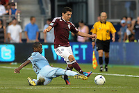 Sporting midfielder Julio Cesar (55) makes a tackle on Rapids Martin Rivero (10)..Sporting Kansas City defeated Colorado Rapids 2-0 in Open Cup play at LIVESTRONG Sporting Park, Kansas City, Kansas.