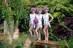Synchronised swimmers make the most of the natural swimming pond featured on the M&amp;G garden at Chelsea. The M&amp;G 2015 Garden  &quot; Retreat&quot; was designed by Jo Thompson. <br /> <br /> 18.5.15<br /> Bethany Clarke / RHS