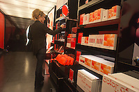 "A Sephora pop-up shop in the trendy Meatpacking District in New York is seen on Wednesday, March 21, 2012. The store, a partnership with Sephora and Pantone promotes the ""Tangerine Tango"" line of products. The color is the official hue of 2012 chosen by Pantone based on their studies of color trends.  (© Richard B. Levine)"