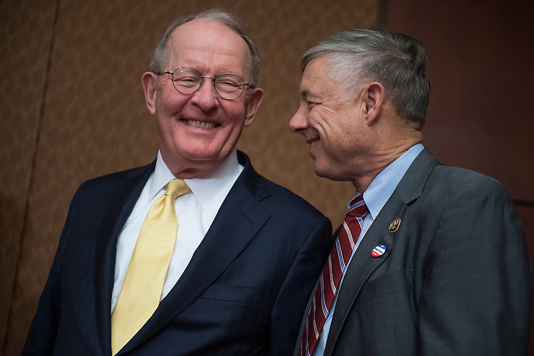 UNITED STATES - DECEMBER 05: Sen. Lamar Alexander, R-Tenn., left, and Rep. Fred Upton, R-Mich., attend a news conference in the Capitol Visitor Center to call on the Senate to pass mental health reform legislation, December 05, 2016. (Photo By Tom Williams/CQ Roll Call)