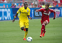 July 27, 2013: Columbus Crew foward/midfielder Dominic Oduro #11 and Toronto FC defender Jeremy Hall #25 in action during an MLS regular season game between the Columbus Crew and Toronto FC at BMO Field in Toronto, Ontario Canada.