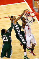 Ohio State Buckeyes forward Sam Thompson (12) is fouled by Ohio Bobcats guard/forward T.J. Hall (13) as he goes up for a shot in the first half of the college basketball game between the Ohio State Buckeyes and the Ohio Bobcats at Value City Arena in Columbus, Tuesday evening, November 12, 2013. As of half time the Ohio State Buckeyes led the Ohio Bobcats 40 - 28. This was the first meeting of the teams in 19 years and the first ever game between them at Value City Arena. (The Columbus Dispatch / Eamon Queeney)