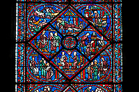 Medieval Windows of the Gothic Cathedral of Chartres, France- dedicated to Joseph the Patriach .  Central panel - bottom Angry that Joseph spurned her, Potiphar's wife accuses him of attempted rape , left - Convinced by his wife's calumny, Potiphar has Joseph arrested , right - Joseph is thrown into prison , top - Pharaoh asleep in his palace, dreaming . A UNESCO World Heritage Site.